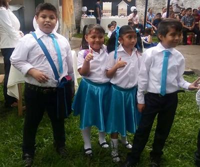 Alumnos de Primaria: Max, Mijael, Fer y Karen.
